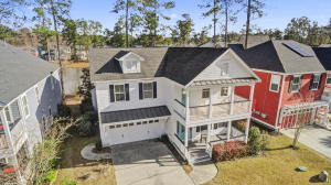 This EXECUTIVE SABIL-BUILT home is move-in ready and sits in one of the best lots in the neighborhood OVERLOOKING the PRIVATE POND with FOUNTAIN!. You will love the views from the SCREENED BACK PORCH or EXTENDED BRICK PATIO and large landscaped back yard! As you pull up to the home you will notice the DOUBLE FULL FRONT PORCHES this is your perfect perch to sip a morning cup of coffee on the second floor or greet guests on the front porch and enjoy the views of this lovely family friendly neighborhood! Inside SOARING CEILINGS and GLEEMING HARDWOODS are throughout the main living area! This open concept floor plan includes the HUGE TWO STORY LIVING ROOM with FIREPLACE with STONE SURROUND and traditional mantel which flows to the GOURMET KITCHEN!!! The Kitchen is complete with GRANITE COUNTER , Custom tiled backsplash, ALL STAINLESS STEEL Appliances including a wall oven, gas range and KITCHEN ISLAND with seating for FOUR and a double undermounted stainless steel sink and dishwasher. The FORMAL DINING ROOM with COFFERED CEILING is just of the kitchen as well as the BUTLERS PANTRY with WET BAR! Travel up the WOODEN STAIRCASE to the MASTER BEDROOM SUITE with VAULTED TRAY CEILINGS, Walk-in Closet with CUSTOM BUILT IN SHELVING, En-suite MASTER BATHROOM with SOAKING TUB, WALK-IN SHOWER and the large laundry room right next door. The additional bedrooms are sizeable and well planned. Close to the best schools, shops, dining and events that Summerville has to offer contact us for a showing Today!