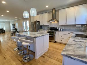 Gourmet kitchen with double oven and upgraded stainless appliance package