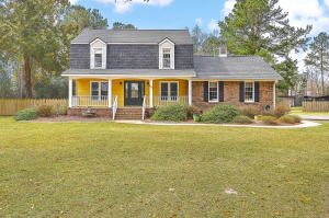 What you have been waiting for! No HOA and on 2.35 acres!  Full country front proch. This beautiful 4 bedroom, 3.5 bath home is ready for you. Hardwoods throughout the first and second floors. Updated eat-in kitchen with granite countertops and lots of cabinets. All appliances convey. Large living room and den with wood burning fireplace. Formal dining room. One bedroom is just off the kitchen with a full bath. Great for guests,teenagers or a home office. Upstairs you will find a large master bedroom with master bath, separate shower and Jacuzzi tub. Another full bath and two additional bedrooms complete the upstairs. Large screened in porch to enjoy your private backyard. Barn/Shop outback is wired for 220V and has a beam mounted wench for heavy loads. It also includes sink and cabinets. Shop includes extra storage upstairs and carport is attached with a large air compressor that conveys. AC and heat as well! Ready for you to complete those projects! You also have a large attached 2 Car Garage! There is a large chicken coop that is currently being used for wood storage. Also a couple of box gardens and a dog run. Light system under the house and termite bond in place. This home and land is the total package your buyers have been looking for. $2000 credit available toward buyer's closing costs and pre-paids with acceptable offer and use of preferred lender.