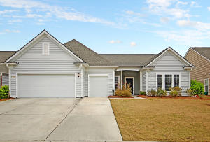 A RARE OPPORTUNITY to purchase a DUNWOODY WAY built in 2015 in Charleston's Premier and established Active Adult community, Del Webb Charleston in Cane Bay! This popular floorpan is rarely available and won't last long! A stunning lagoon homesite with close proximity to the  community's amenity center!  Step into the foyer and prepare to be impressed. This thoughtfully designed home features 3 bedrooms, 3 baths, dual masters, office/den, sunroom, extended 2.5 car garage with golf cart parking and walk-up attic storage above the garage.  Vast open-concept living with combined kitchen, great room dining area, and sunroom. Hardwood floors extend throughout all main living areas with tile flooring in the baths and laundry. Upgraded cabinets with crown molding, granite countertops, stainless... steel gourmet appliances featuring a gas cooktop, built-in wall oven/microwave, dishwasher, French door refrigerator with bottom freezer, subway tiled backsplash, and corner pantry. Conveniently tucked away in the back corner of the home, you will find your perfect owner's retreat finished with a tray ceiling and complete with the largest walk-in closet that the builder offered in any floor plan. Master bathroom features dual vanities, granite countertops and tiled walk-in 5 foot shower with built-in seat. Next to the shower, an open area prefect for a ladies vanity, dresser, or built-ins for extra storage. Located on the other side of the home, the second bedroom is a true guest suite with an attached full bath. This bedroom is oversized so it could also work as a second master.  A light-filled sunroom with lagoon views is a great place to enjoy your morning coffee or lounge with a good book. Off of the foyer you will find an office/den/flex room with glass French doors that could also be used as a formal dining room. Another full bedroom and bathroom is located down a separate hallway creating maximum privacy for visiting friends and family. The spacious laundry room leads you t