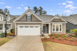 This gorgeous home is a Summerville stand-out, from its charming exterior to the luxurious upgrades that await inside. Over the threshold you'll find an entrance hallway that leads to an open floor plan living space, with vaulted ceilings and oversized windows lining the back wall. Abundant natural light floods the living room and dining area, which flow seamlessly into the kitchen - complete with stainless steel appliances, gas range, walk-in pantry and large island. The most stunning eye-catching feature is the leathered granite counters which you will be sure to love. This layout is ideal for entertaining or spending a relaxing night in, gathered around the fireplace! The master bedroom's unique tray ceilings and large windows transform the already spacious room into a luxurious oasis. This light, airy vibe is continued in the ensuite bathroom, where you'll enjoy plenty of counter and storage space. And don't forget to check out the enormous walk-in closet! The screened-in porch takes outdoor living to the next level, offering a stunning view of the tiled patio and the backyard beyond. Both the porch and the patio are tiled and very few of the homes have exterior porch and patio tile, so this is a true luxury. Imagine greeting the day here, cup of coffee in hand, as the birds chirp and you soak in the beauty of the Lowcountry. This home is ideally located in the gated Cresswind Community, with access to the Clubhouse, exercise area, pool, hot tub, playground and walking trails  meticulously maintained by the $249/month HOA fee. It is an active adult community with regulations revolving around that- please ask the listing agent for more details. Just south of Downtown Summerville, close to shopping, dining and entertainment, this ideally-located house is ready to become your next dream home!  Use preferred lender to buy this home and receive an incentive towards your closing costs!