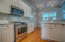 Kitchen was just updated with marble counters and tile backsplash