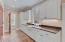 Butler's pantry offers custom shaker cabinetry, slate flooring, and granite countertops