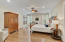 1st floor Master Bedroom is spacious and light filled, with entry to back porch and pool.