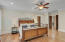 Lovely walnut flooring throughout the home with 10 ft ceilings and custom doors throughout