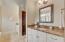 Master Bath offers dual vanities, granite countertops and travertine floors