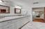 Bathroom #3 upstairs offers granite countertops, custom tile and fixtures, and dual vanities