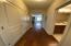 Open hallway into living area/kitchen