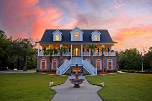 A TRUE RARE FIND! ONLY 4 miles to City of Charleston! 6,006sf Gorgeous Lowcountry Home with a 1,199 sf apartment on the first level, 6,000+ Sf detached garage, 30 private acre property gated on the water, in-ground pool w/ water feature, private boat landing and dock on Scenic Hwy 61...WHAT MORE CAN YOU ASK FOR!  The kitchen has plenty of custom cabinetry, BEAUTIFUL NEW marble countertops with a BRAND NEW Jennair GAS stove with built-in downdraft.  The house has a 10+car garage plus the additional detached garage which could be another home. The master has dual bathrms and sitting area. The upstairs bedrms are huge with full bathrms and walk-in closets.  The apartment is complete with living room & dining room.(Main living area is 4,807sf and the full apartment is 1199sf). PICTURES do not