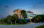 Charleston single, with reverse floor plan, is located on the popular West End of the island.
