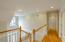 Upstairs hallway open to foyer below