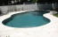 Large Gunite pool with custom travertine deck