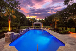 Stunning crystal blue pool with 3 waterfall features. Brick paver patio, custom built gazebo with ceiling fan and an outlet for a TV, custom landscaping and irrigation. New pump, new liner, new plumbing. The filter has an ionizer. There is also a self filling and self draining feature.