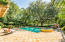 The stunning pool offers great sunlight but also shade from the striking oak trees on property.