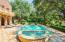 The limestone tile pool deck creates a beautiful setting.