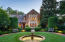 Distinctive and refined European gardens in front and back of the home.