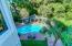 Side deck view of backyard oasis