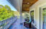 Owner suite private balcony overlooking backyard oasis