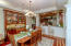 Dining in the spacious dining room with built china cabinet just off from the gourmet kitchen