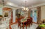 Gourmet kitchen, dining room and great room all flow together separate by archways with open air setting
