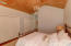 Check out the cathedral finished ceilings in upstairs guest suite with private bath and balcony