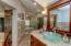 Main bath with double separate vanities including fireplace and walk in shower