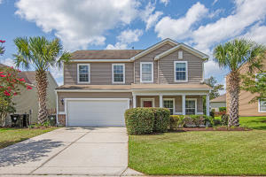 Beautifully landscaped yard with mature palmetto trees.