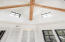 Pecky cypress beams hilight this one-of-a-kind office with a three-tiered ceiling!