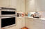 Butlers Pantry between kitchen and formal dining room has extra oven and a microwave!