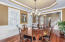 Large formal dining room with detailed moldings and wainscotting