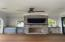 """Nearing completion of the """"summer kitchen"""" with added countertops, TV, and fan..."""