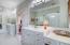 Dual vanities, water closet and large linen closet