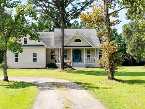 This amazing property is what you have been hoping to find, but a rare opportunity since it's a mini farm with enough room for a huge garden, guest house, and accessory structures. This lovely custom built home is located on 2.5 acres with quick access to 26, Nexton Square and Summerville. with nearby restaurants, shopping and schools. The home is exceptional in quality, style, design and finishes with high ceilings, crown molding, fireplace, granite counters, oak hardwood flooring, screen porch and finished bonus room. The designer finishes include heavy moldings, ceramic tile flooring in the bathrooms, architectural windows, columns, high ceilings, stylish lighting, decorator paint colors, and fine cabinetry. There is an attached 2-car garage as well as a detached 2-car garage and --- workshop. Zoning is R-2 manufactured residential.  No HOA. The well house at the front covers a yard well that is not operable at the present time and the Sellers do not plan to repair or replace the pump. The fireplace is wood burning, but can be converted to gas.