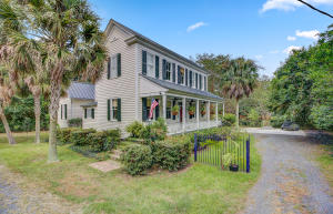 A beautiful, fully remodeled, late 1890's home within walking distance to downtown Summerville, parks, and Dorchester District 2 Schools.  As you enter the home, you will notice the grand main hallway with formal living and dining room. Continue down the hallway to the gourmet kitchen. The open floor plan kitchen/living room is perfect for entertaining with additional sunroom/office/playroom adjoining the space. Off the living room is the master suite that is tucked away on the main floor and includes a huge bedroom with fireplace, large walk in closet, and bathroom with space to make additional upgrades. Upstairs has 3 large bedrooms with a shared bathroom. Additional features to appreciate include; beautiful grounds on the half acre lot, 10 ft. ceilings, refinished heart pine floors, extensive moldings, large rooms for entertaining, 6 fireplaces, ultra upgraded kitchen with Wolf range-farmhouse sink- & custom cabinetry. Structural upgrades to home include; replacement of main metal roof, upgraded electrical per professional recommendation, plumbing upgrades, additional parking pad, spray foam insulation in areas, and so much more! This is a chance to own a piece of history with the advantage of a remodeled interior completed with style and charm. Home inspection has already been performed with no major concerns. Similar homes are over $200 per sq ft.  We are priced to allow buyer to make additional upgrades.  We are also priced in line for the community at $183 per sq ft. Ask your agent for 3d and video tour of home! NO HOA!