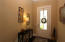 Well-lit foyer with natural lighting, chandelier, & space for entry table!