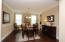 Upgraded Dining Room with gleaming hardwoods, cove crown molding, tall baseboards, chairrail and beautiful Chandelier! Columns frame the entry to this gorgeous space!