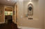 Wide foyer with lighted Niche for displaying wall art!