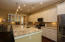 White Cabinets abound! Tall ceilings with recessed light add to the spaciousness!
