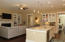 Very large Island with special Granite countertop! Currently has 4 barstools!