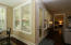 Notice the gorgeous hardwood flooring leading to the huge Owner's Suite with double door entry!