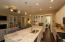 A Beautiful Kitchen with an abundance of counterspace. Recessed lighting and pendants add so much light and ambiance!