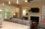 Lovely Pendant lighting over beautiful granite countertops! Ceiling Fan in summer and Gas Logs for Winter!