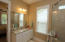 Two large vanities are in the Owner's Bathroom with Granite countertops and undermounted sinks, nice lighting, and plenty of space!