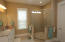 The Owners Bathroom is special with Tiled Flooring and a very large high Tiled Shower with transom window, upgraded showerhead, and semi-frameless shower door!