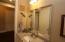 Lovely white vanity with granite top, tile flooring!