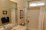 Full tub-Shower combo with transom window for additional lighting.