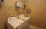 Laundry room is quite large and Washer & Dryer will convey. Has shelving over the appliances plus....