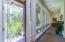 Beautiful impact glass walls of windows throughout the home