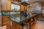 Beautiful granite counters accent the custom Cherry cabinetry