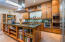 Epicurean's kitchen with double Wolf ovens, gas cooktop and vented hood, Sub Zero refrigerator, Bosch dishwasher, Wine Cooler